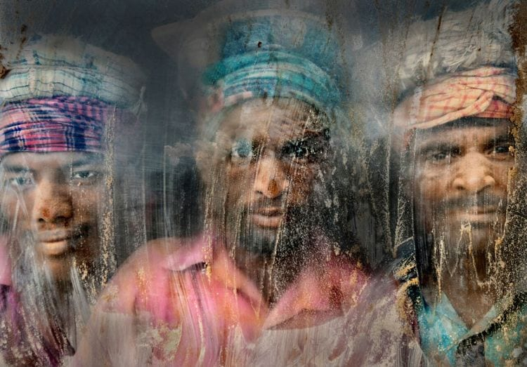 2. Gravel Workmen[This] gravel-crush working place remains full of dust and sand. Three gravel workmen are looking through the window glass at their working place. Chittagong, Bangladesh. Photo and caption by Faisal Azim/National Geographic Traveler Photo Contest